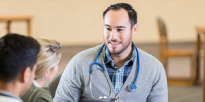 A couple talks with their Doctor. With Defence Health's Access gap program you can reduce your out-of-pocket costs.